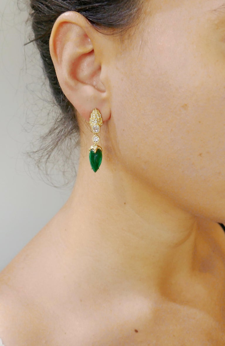 Lovely dangle earrings.  Beautiful color combination of vivid green emeralds and sunshine of yellow gold with a subtle sparkle of diamonds along with an outstanding workmanship make the earrings a great addition to your jewelry collection.  Made of
