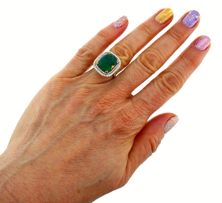 Sparkly and colorful ring. Timeless, chic and elegant, the ring is a great addition to your jewelry collection. It is made of 18 karat (stamped) rose and white gold and features a gorgeous color 10.50-carat cushion cut emerald framed by a row of