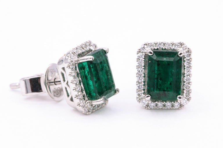 Contemporary Emerald Diamond Halo Stud Earrings 2.52 Carat 14 Karat White Gold For Sale
