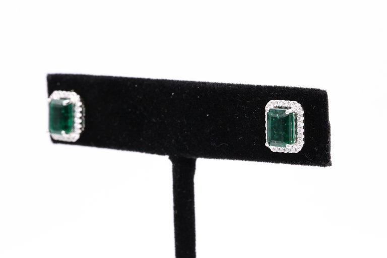 Emerald Diamond Halo Stud Earrings 2.52 Carat 14 Karat White Gold For Sale 1