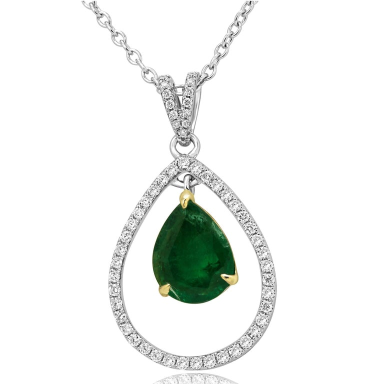 Stunning Zambian Emerald Pear shape 1.75 Carat encircled in a halo of White Round Diamonds 0.37 Carat in 14K White and Yellow Gold Chain Necklace.  Style available in different price ranges. Prices are based on your selection of 4C's Cut, Color,