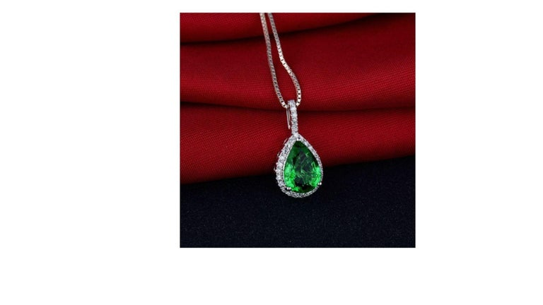 This Emerald necklace stands out  in this pear cut  with 30 diamonds around the main stone and is set in 18k white gold.    If you are looking for anything specific let us know as you can  also have something custom made too      Diamonds: Natural