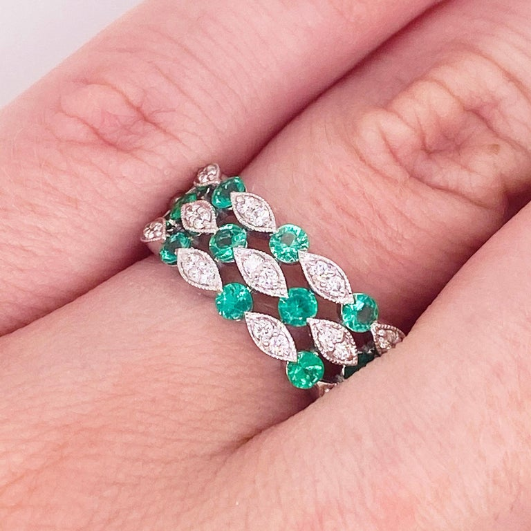 The wide band ring with alternating emeralds and diamonds is an amazing design!  The pop of the green emeralds that were sourced from Columbia is stunning and the way the jeweler set the stones is very interesting and original.  The round shape of