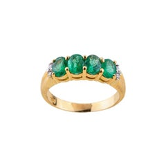 Emerald Diamond Ring in 18 Karat Yellow Gold