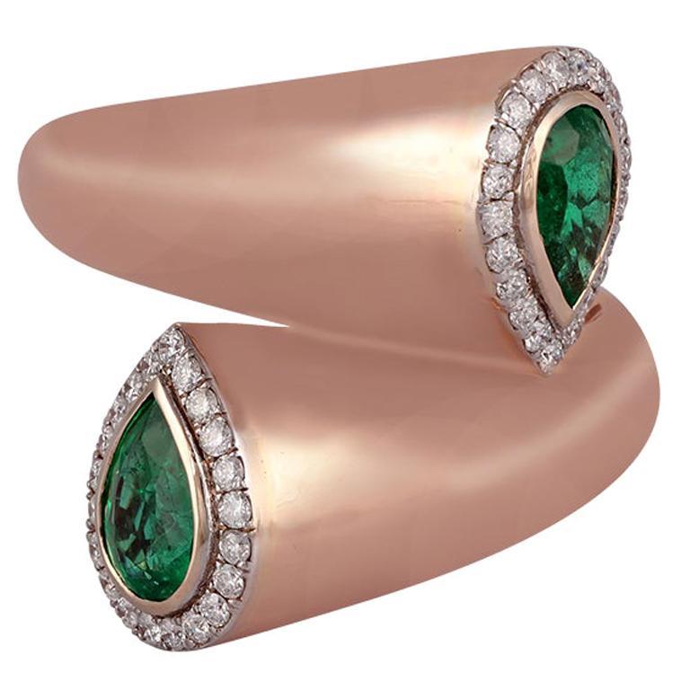 Emerald Diamond Ring Studded in 18 Karat Gold