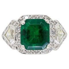 Emerald and Diamond Three-Stone Ring in 18 Karat White Gold