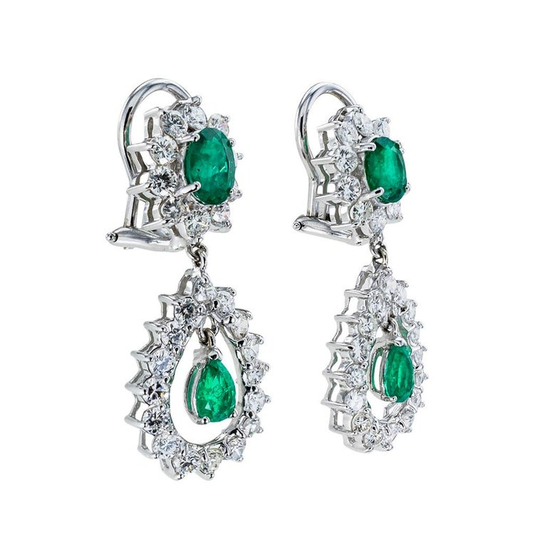 Emerald diamond and white gold drop clip on earrings circa 1960.    The facts you want to know are listed below.  Read on.  It is remarkably short, simple, and clear.  Contact us right away if you have additional questions.  We are here to connect