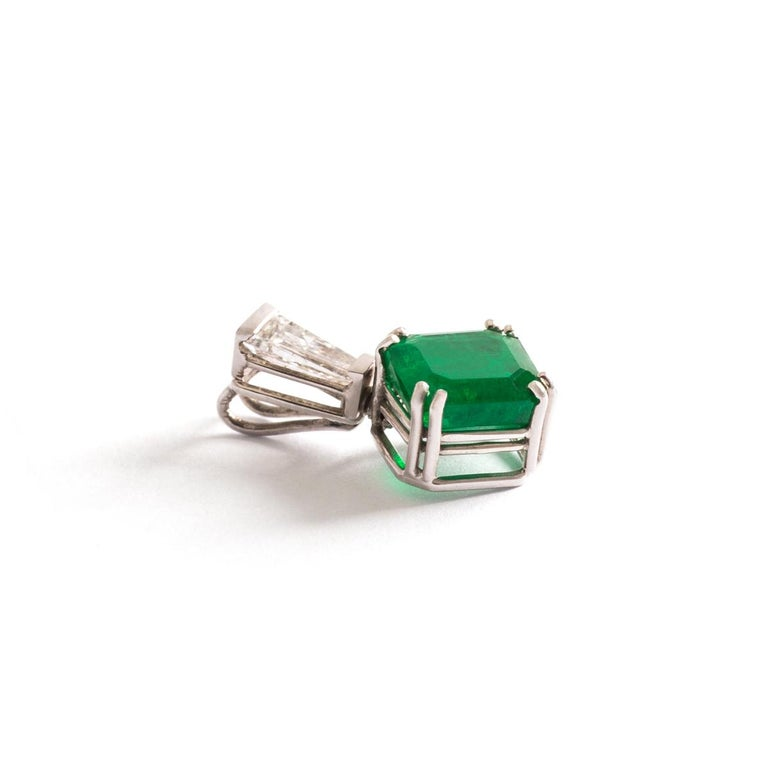 Emerald Diamond White Gold Pendant. Emerald size: 6.09 x 5.41 millimeters. Length: 1.50 centimeter. Width: 0.90 centimeter. Gross weight: 0.97 grams