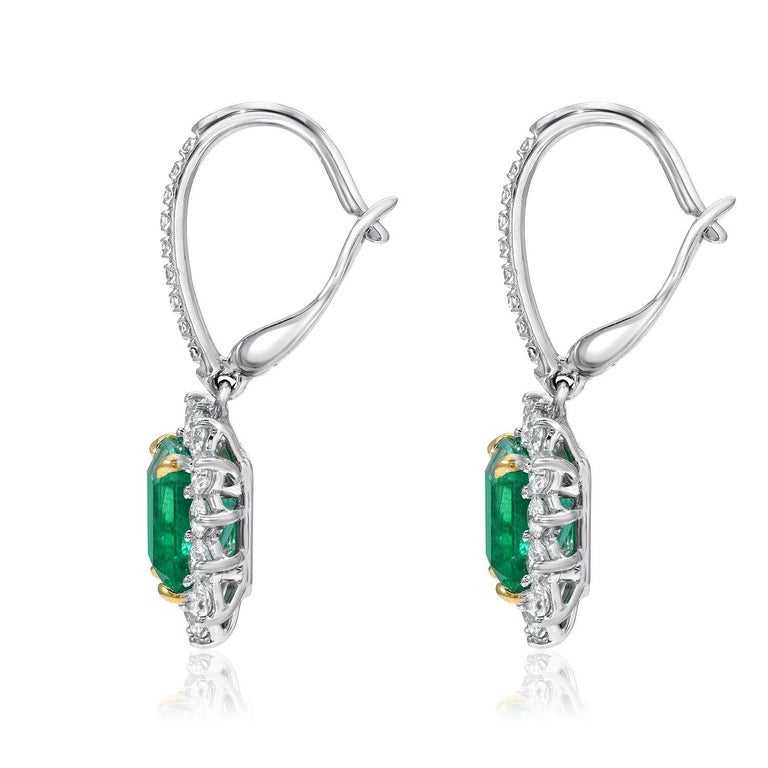 Emerald cut Colombian Emerald, lever-back earrings, featuring a pair of 2.86 carats total Emeralds, and a total of 1.20 carats round brilliant diamonds, in 18K white and yellow gold. Returns are accepted and paid by us within 7 days of