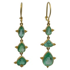 Emerald Earrings in Marquise and Pear Shapes Set in 18 Karat Yellow Gold