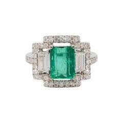 Emerald Emerald Cut and White Diamond Three-Stone Ring in 18 Karat White Gold
