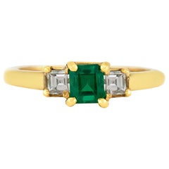 Emerald Engagement Band with Two Princess Cut on the Side