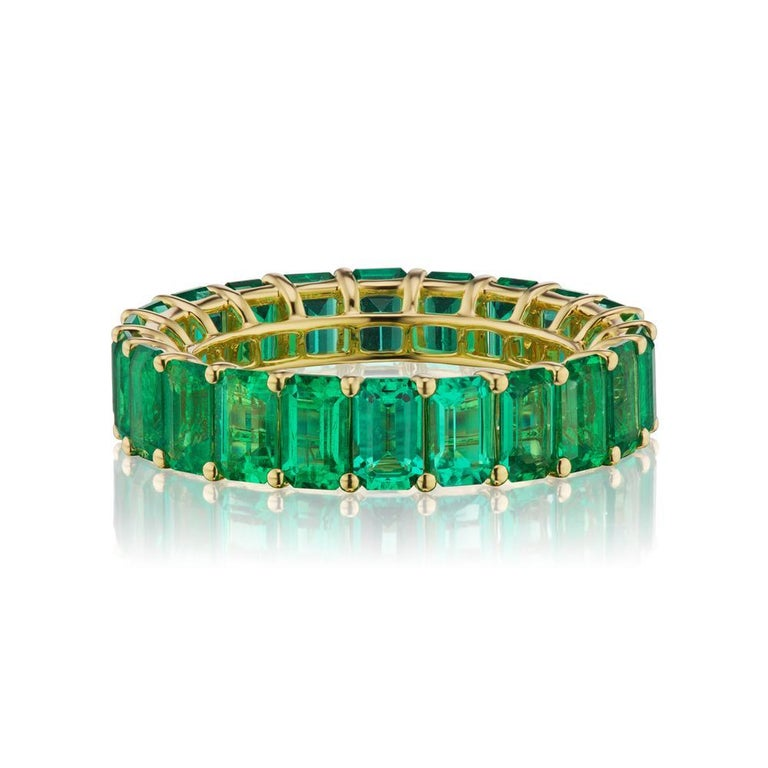 EVERGREEN EMERALD ETERNITY BAND BY TAKAT A timeless eternity Emerald band in 18k Yellow Gold with emerald-cut stones around. This design is one for the classics. ( Ring Size 6.5 ) Item:# 03794 Setting:18K Y Color Weight:5.75 ct. of Emerald