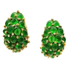 Emerald glass cabuchon and clear paste 'cluster' earrings, Marcel Boucher, 1960s