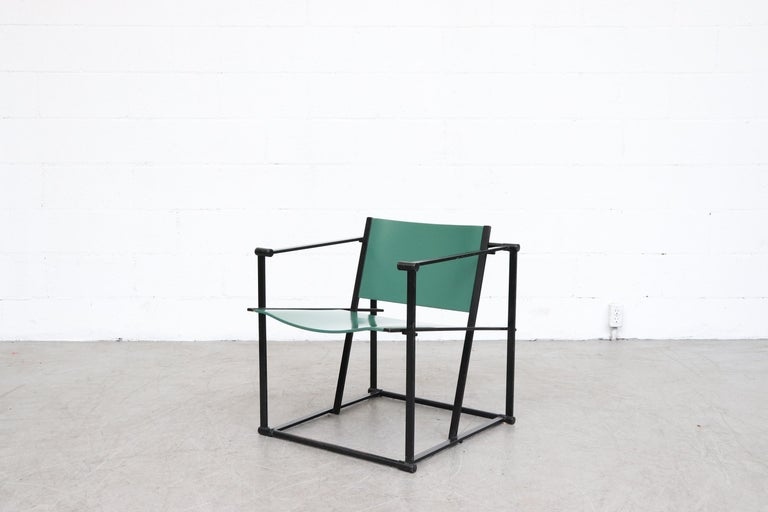 UMS Pastoe FM60, cubic chair lounge chair, designed in 1980 by Radboud van Beekum for Pastoe. Black enameled steel frame with green painted molded wood seating. Frame is in original condition with some wear to enamel. Some wear and minimal chipping