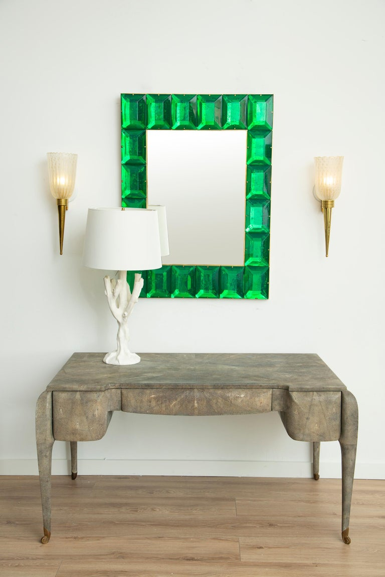 Emerald green diamond Murano glass mirror. Customizable faceted Murano glass mirror in emerald green Contemporary and customizable mirror with a faceted Murano glass frame, edged in brass and handcrafted by a team of artisans in Venice, Italy. Each