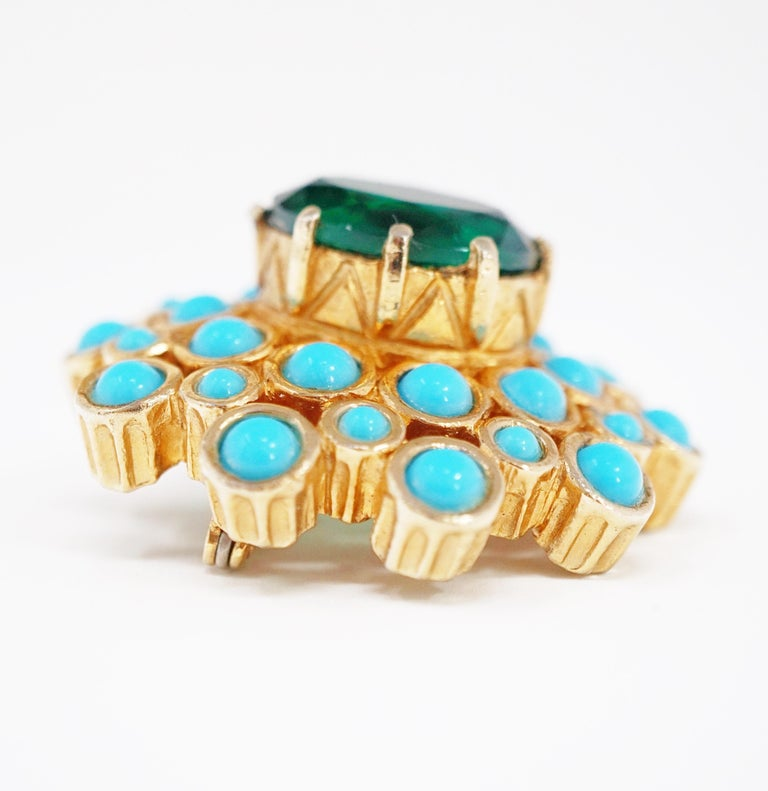A wonderful example for the Mid-Century Modern jewelry collector, this beautiful vintage gold-tone statement brooch with vivid Emerald-colored rhinestone surrounded by faux Turquoise is by Jerry DeNicola, circa 1960, and signed on the brooch's