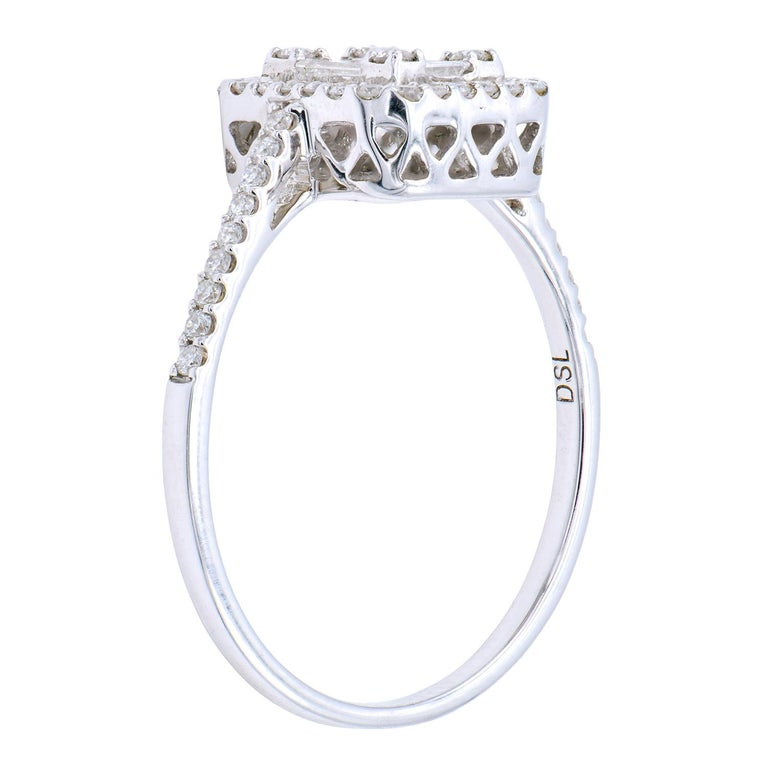 This stunning emerald illusion diamond ring is sure to be loved. A combination of round and baguette diamonds are expertly matched and put together to create the look of an emerald diamond. It is then surrounded by a halo of more diamonds and