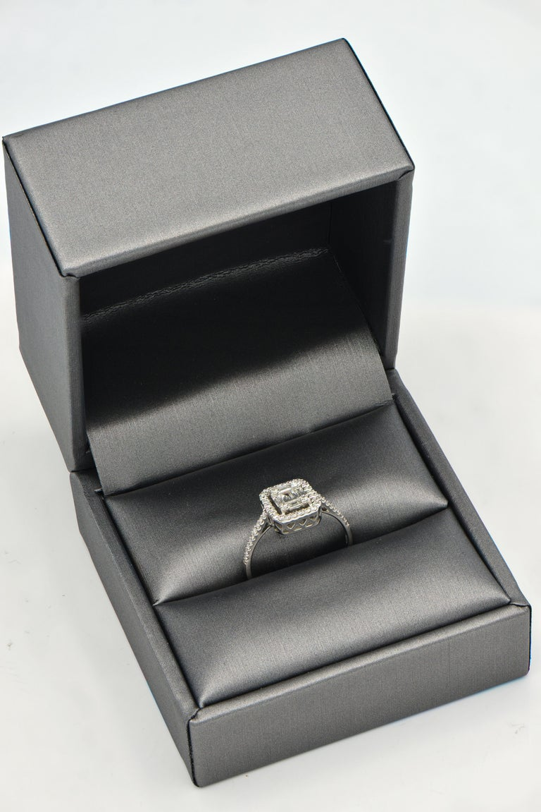 Contemporary Emerald Illusion with Halo Diamond Ring For Sale
