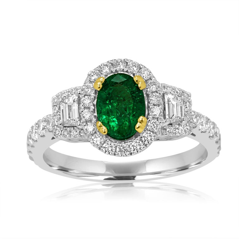 Gorgeous Emerald Oval 0.80 Carat encircled in a single Halo of White Round Diamonds 0.37 Carat Flanked with 2 White Diamond Trapezoids on the side 0.16 Carat in 14K White and Yellow Gold Thee Stone Cocktail Ring.  Total Stone Weight 1.33