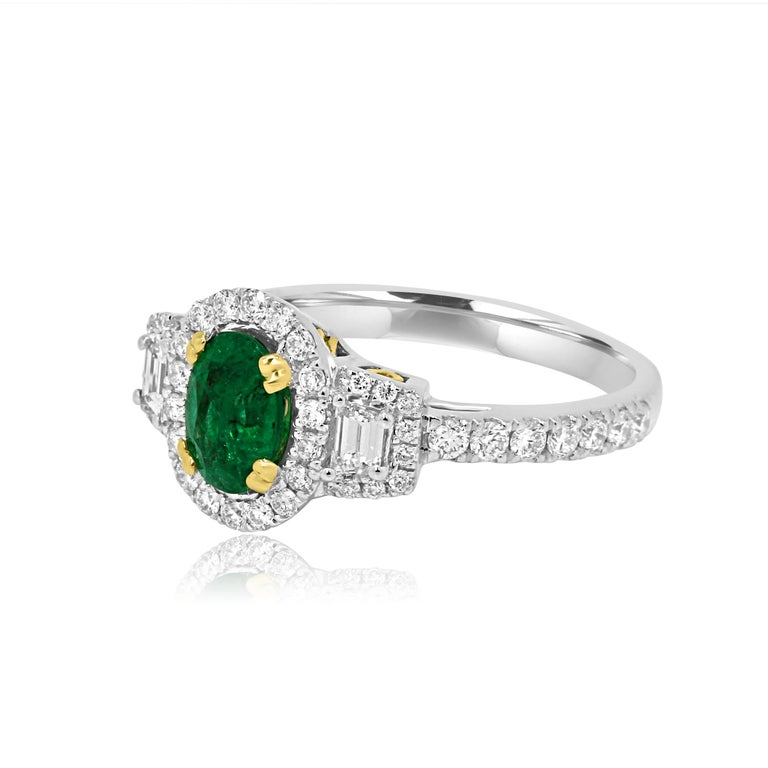 Oval Cut Emerald Oval and Diamond Halo Three-Stone Two-Color Gold Bridal Fashion Ring For Sale