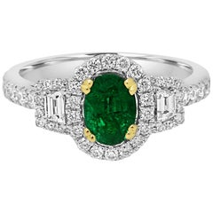 Emerald Oval and Diamond Halo Three-Stone Two-Color Gold Fashion Ring