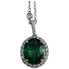 Emerald Oval Cut Pendant Necklace with Diamonds