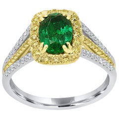 Emerald Oval Fancy Yellow Diamond Halo Two-Color Gold Bridal Fashion Ring