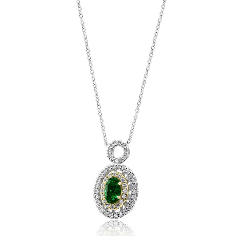 1 Emerald Oval 0.43 Carat Encircled in Double Halo of 59 White G-H Color VS-SI clarity Diamond Rounds 0.52 carat set in stunning 14K White and Yellow Gold Pendant Diamond By Yard Chain Necklace .  Total Stone Weight 0.95 Carat  Style available in