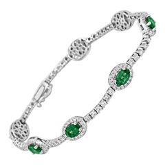 Emerald Oval White Diamond Round Halo 5.50 Carat Total Weight Gold Bracelet