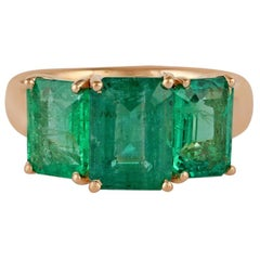 Emerald Ring Studded in 18 Karat Yellow Gold
