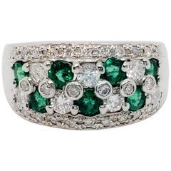 Emerald Round and White Diamond Band in Platinum
