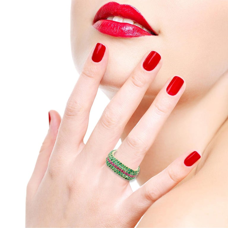 This eternity ring has been meticulously crafted from 18-karat gold.  It is hand set in 3.04 carats emerald & .98 carats ruby.  The ring is a size 7 and may be resized to larger or smaller upon request.  FOLLOW  MEGHNA JEWELS storefront to view the