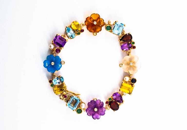 This Bracelet is made of 14K Yellow Gold but we can make it also in 9 or 18K Yellow Gold. This Bracelet has 0.20 Carats of White Modern Round Cut Diamonds. This Bracelet has 0.90 Carats of Blue Sapphires, Rubies and Emeralds. This Bracelet has also