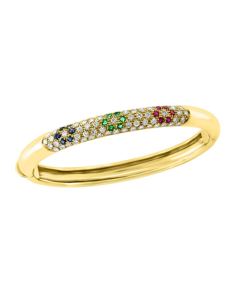 Emerald Ruby Sapphire & Diamond  Cuff  Bangle Bracelet In 18 Karat Yellow Gold  A spectacular jewelry piece.  This exceptional  and very reasonable in price Bangle bracelet has Three Flowers  one  of each Ruby  Emerald and Sapphire weighing