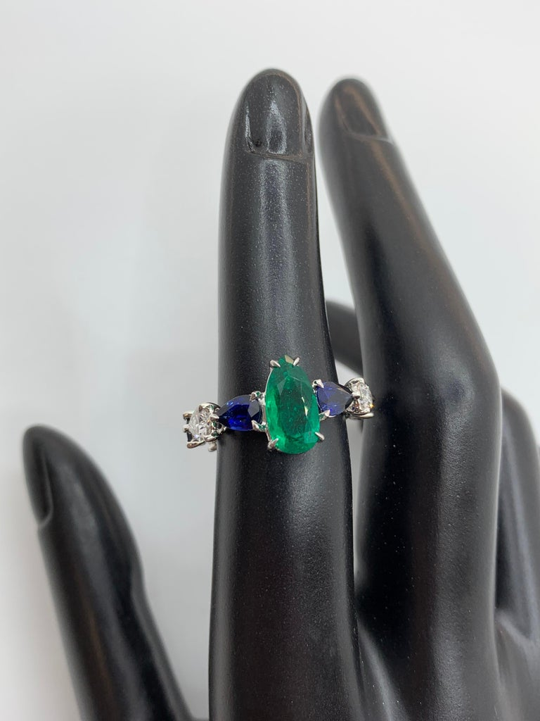 Contemporary Emerald Sapphire and Pear Shaped Diamond Ring For Sale