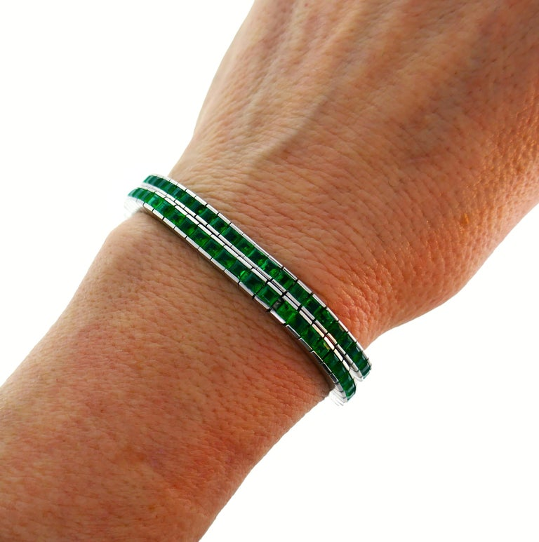 A pair of stunning ideally matched emerald and 18 karat white gold tennis bracelets. Each bracelet is substantial on its own and great for piling up. Once bracelet is made by Meister and features fifty-nine table cut emeralds approximately 0.15