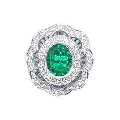 Emerald with Diamond Pendant Set in 18 Karat White Gold Settings