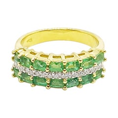 Emerald with Diamond Ring Set in 18 Karat Gold Settings