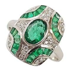Emerald with Diamond Ring Set in 18 Karat White Gold Settings