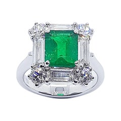 Emerald with Diamond Ring Set in 18 Karat White Gold Settings