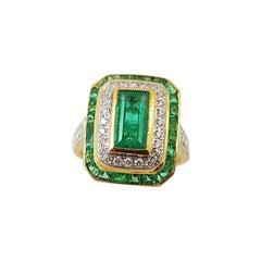 Emerald with Diamond Ring Set in 18 Karat Gold Settings