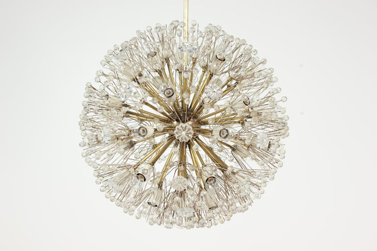 """Spectacular, 1960s Emil Stejnar """"Dandelion"""" chandelier for Rupert Nikoll, Austria. This sparkling orb is one of the larger versions of this design. The chandelier consists of a brass body and arms with white enameled socket covers (each surrounded"""