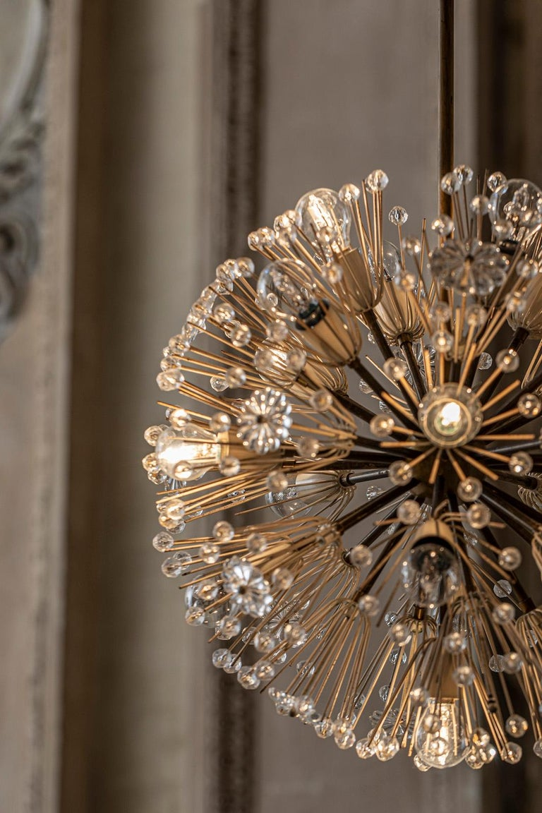 Elegant 18 lights Sputnik chandelier by Emil Stejnar. Brass and glass charming pendant. Very good original condition.