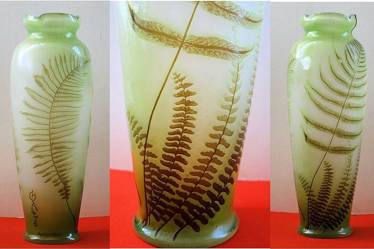 Emile GALLE Tall Cameo Glass Vase with Fern ornaments   Crafted in Nancy (Lorraine) c. 1905 Bearing Galle 'japanese' signature in cameo Made of white opalescent glass with light green shades, overlaid in cameo pale green / brown ornaments of Fern,