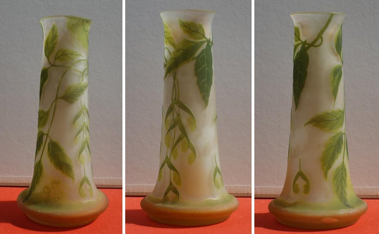 Emile GALLE Tall Cameo Glass Vase with Maple ornaments   Crafted in Nancy (Lorraine) c. 1905 Bearing Galle 'Japanese style' signature in cameo Made of white opalescent glass with light orange shades, overlaid in cameo pale green ornaments of