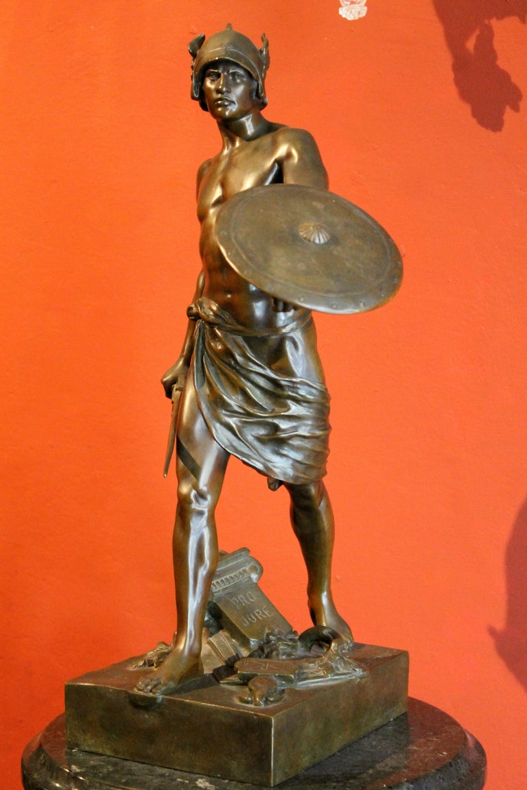 This extraordinary French burnished bronze figurative sculpture featuring a Gallic warrior victorious over the Roman legion was crafted in late 19th Century (1890 ca) by famed French sculptor E´mile-Louis Picault, one of the most celebrated