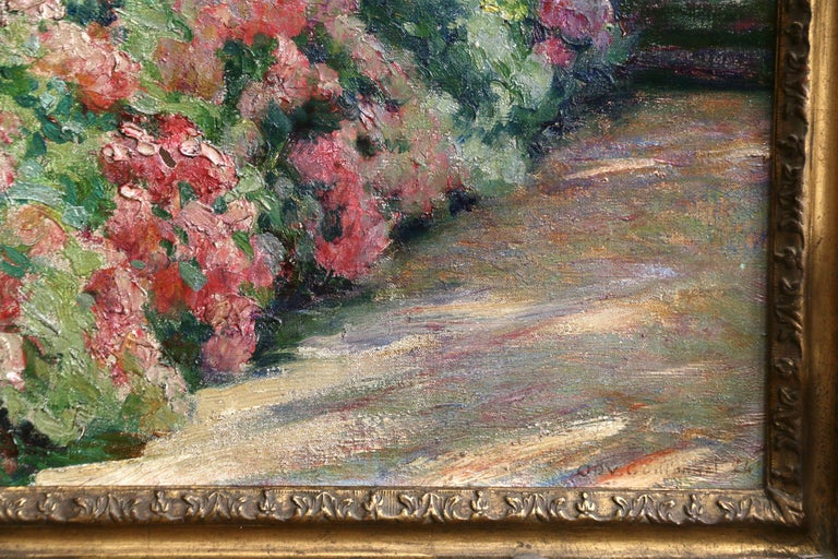 A wonderful and beautifully coloured oil on original canvas by Octave Guillonnet depicting a garden in bloom. Signed and dated 1924 lower right. Framed dimensions are 22 inches high by 19 inches wide.  Émile Guillonnet was a student of Lionel Royer