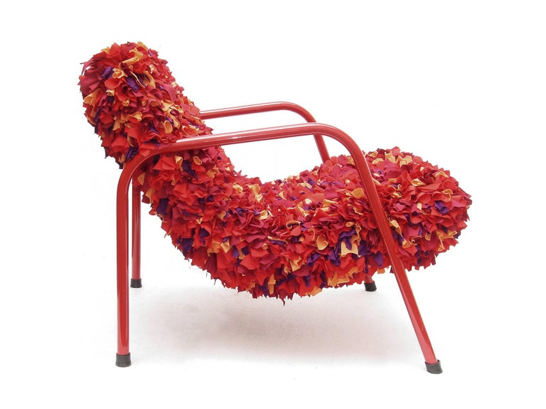 This Easychair is another piece of the designers Leonardo Lattavo and Pedro Moog that rescues traditional Brazilian handcraft techniques. The chair upholstery consists of knots of small pieces of recycled fabric tied up by hand. 'Emília' is