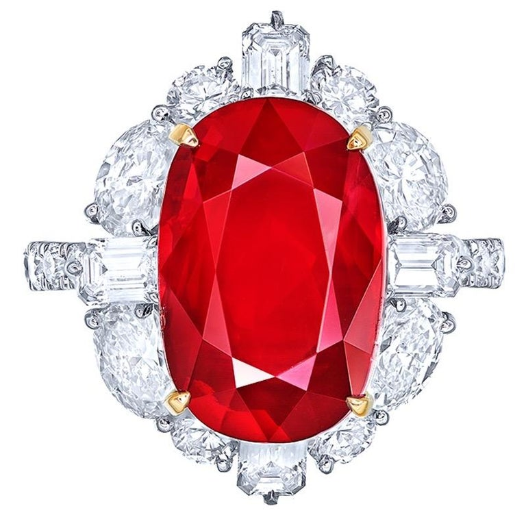 From the Museum Vault at Emilio Jewelry New York,  Main stone: 10.00 carat Pigeon Blood (Vivid  Red) OVAL Setting: 24 white diamonds totaling about 0.704 carats, 4 white diamonds totaling about 0.52 carats, 4 fancy-cut white diamonds totaling about